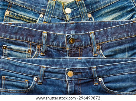 Blue jeans in stack on display in shop - stock photo