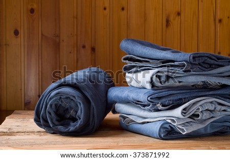 Blue jeans on a brown wooden background - stock photo