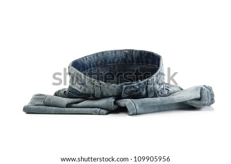 Blue jeans on the floor showing the rounded form of the waist - stock photo