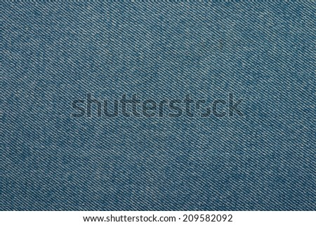 Blue jeans texture 3. Denim fabrics texture of blue color. Diagonal lines - stock photo