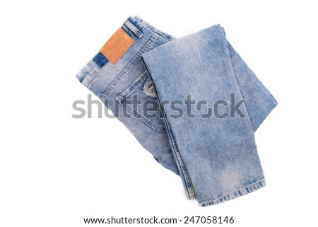 Blue jeans with leather label isolated on white background - stock photo