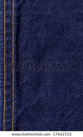 Blue jeans with yellow stitch texture - stock photo