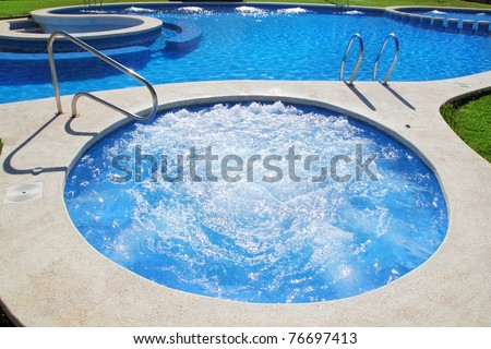 blue jet spa pool in green grass garden outdoor day - stock photo