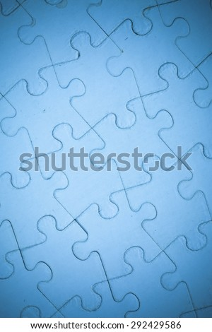 Blue Jigsaw puzzle background.