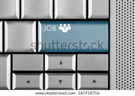 Blue JOB key on a computer keyboard with clipping path around the JOB key - stock photo