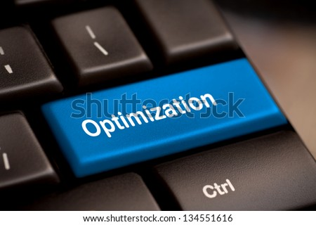 Blue key with Optimization word on laptop keyboard. - stock photo