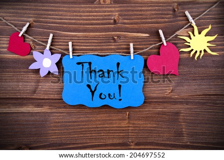 Blue Label with the Words Thank You, Hanging on a Line with Different Symbols - stock photo