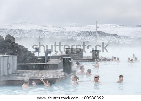 Blue lagoon, Iceland - February 20, 2016: People are resting in SPA, Blue lagoon - a geothermal bath resort in the south of Iceland, in winter. - stock photo