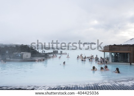 Blue lagoon, Iceland - February 20, 2016: People in SPA near  a cafe in the water, Blue lagoon - a geothermal bath resort in the south of Iceland, in winter. - stock photo