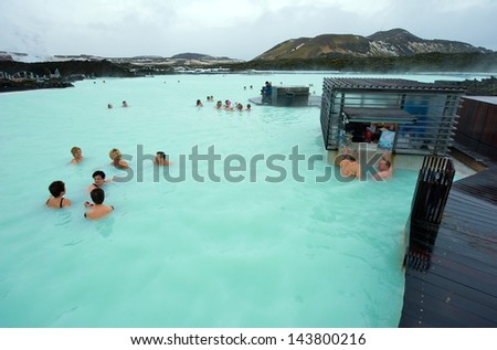 BLUE LAGOON, ICELAND - MAR 08: People bathing in The Blue Lagoon, a geothermal bath resort in the south of Iceland, a 'must see' by tourists. March 08, 2013 in Iceland. - stock photo