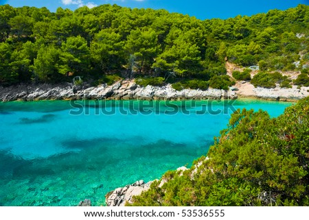Blue lagoon in Adriatic Sea, on Korchula island of Croatia coastline - stock photo