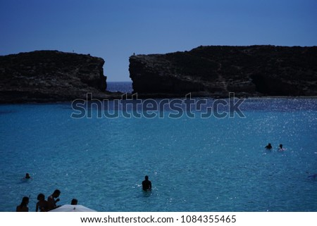 https://thumb9.shutterstock.com/display_pic_with_logo/167494286/1084355465/stock-photo-blue-lagoon-in-malta-island-1084355465.jpg