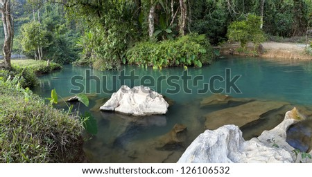 blue lagoon in Vang Vieng, Laos, travel destination with clear water and tropical landscape - stock photo