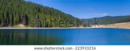 Blue lake in the highlands. Ukrainian Carpathians. Bukovel - stock photo