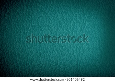 blue leather background or texture with dark vignette borders