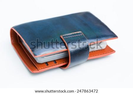 Blue leather name card pocket on white background - stock photo
