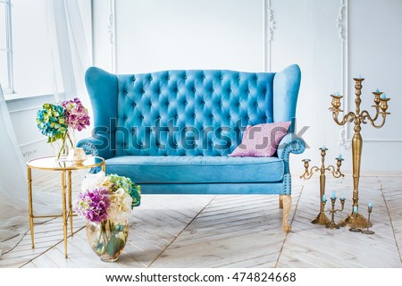 Blue Leather Sofa The Golden Candlestick Vase With Flowers On Background Large White Room