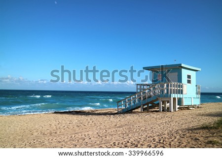 Blue Lifeguard station, blue sky, ocean and sand on a sunny day in Miami, Florida - stock photo