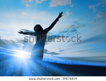 Blue light and young woman in field - stock photo