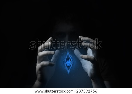 blue light in hands - stock photo