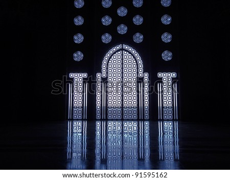 Blue light reflects off marble floor from illuminated stained glass windows framing doorway into mosque in Casablanca - stock photo