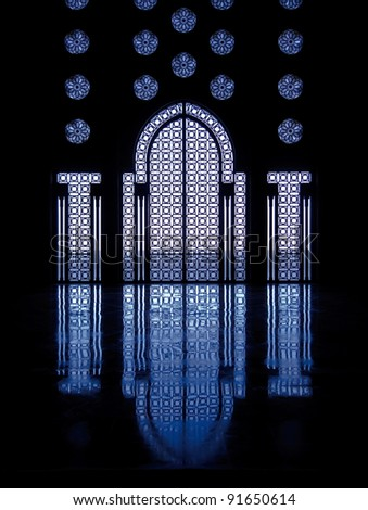 Blue light reflects off marble floor from illuminated stained glass windows framing doorway into mosque in Casablanca, Morocco