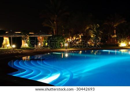 blue light swimming pool at night - stock photo