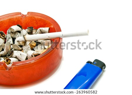 Blue Lighter and cigarette in ashtray on white  - stock photo