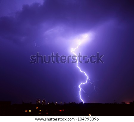 Blue lightning bolts in the night skies - stock photo
