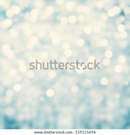 Blue Lights Festive background. Abstract Christmas twinkled bright background with bokeh defocused silver lights - stock photo