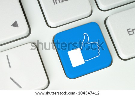 Blue like button on keyboard - stock photo