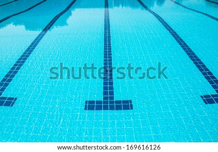 Blue line of lane in clear swimming pool - stock photo
