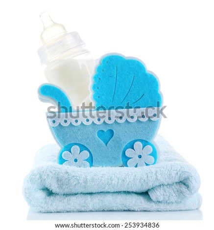 Blue little pram and bottle of milk isolated on white - stock photo