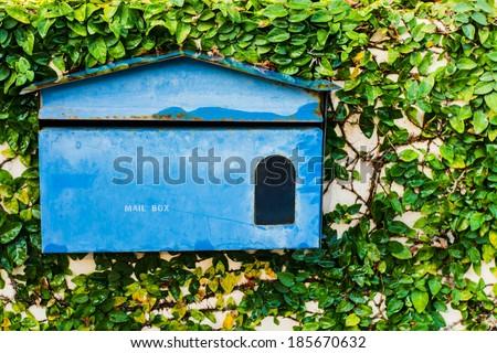 Blue mailbox - stock photo