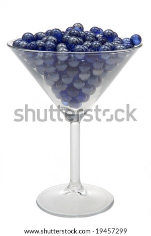 Blue marbles resting in a martini glass.