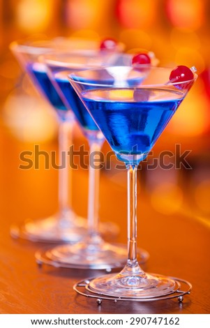 Blue Martini cocktail shot on a bar counter in a nightclub