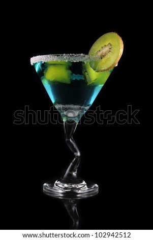 blue martini drink with kiwi and yellow ice on black background - stock photo