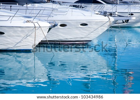 blue mediterranean sea water in marina port of Spain - stock photo