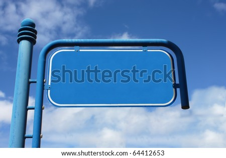 Blue, metal, empty street sign with cloudy sky on the background - stock photo