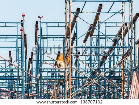 Blue metal scaffold on the construction building in Thai temple. - stock photo