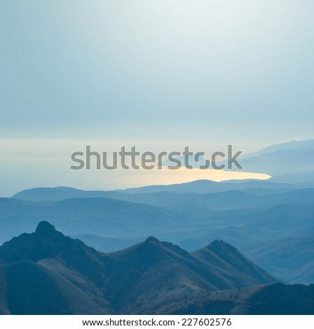 blue misty mountains and a sea bay - stock photo