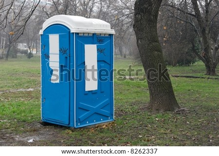 Blue mobile toilet cabin in a park - stock photo