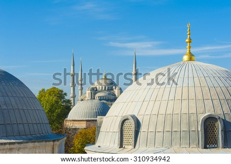 Blue Mosque (Sultan Ahmet Mosque) and cupolas seen from Hagia Sophia  - stock photo