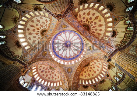 Blue Mosque (Turkish: Sultan Ahmet Cami) ornate interior ceiling in Istanbul, Turkey - stock photo