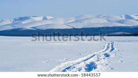 Blue mountain landscape in winter - stock photo