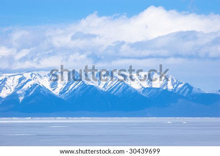 blue mountains under clouds at winter Baikal