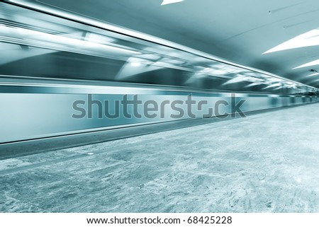 blue moving train - stock photo