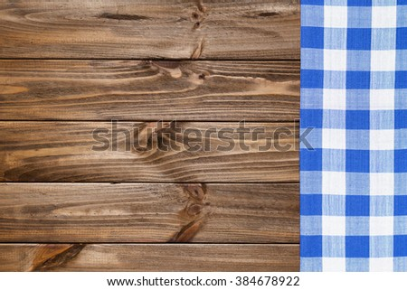 Blue napkin on the old wooden table. - stock photo