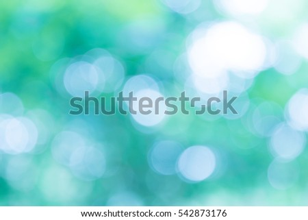 blue natural background of out of focus forest or bokeh