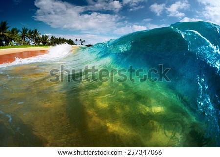 Blue ocean wave breaking on the sandy tropical beach. Sri Lanka - stock photo